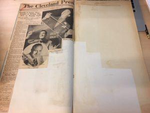 Acid burn in a Whiteman scrapbook.
