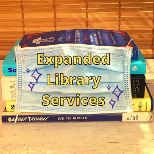 """A stack of books with spines covered with a blue face mask. """"Expanded Library Services"""" is superimposed on the mask in yellow text."""