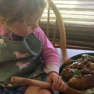 A family member examines the dish